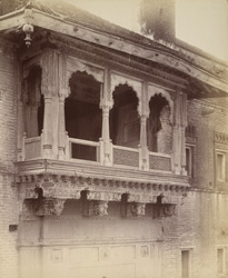 Close view of private house showing details of wood-carving on balcony and supporting brackets, Srigonda
